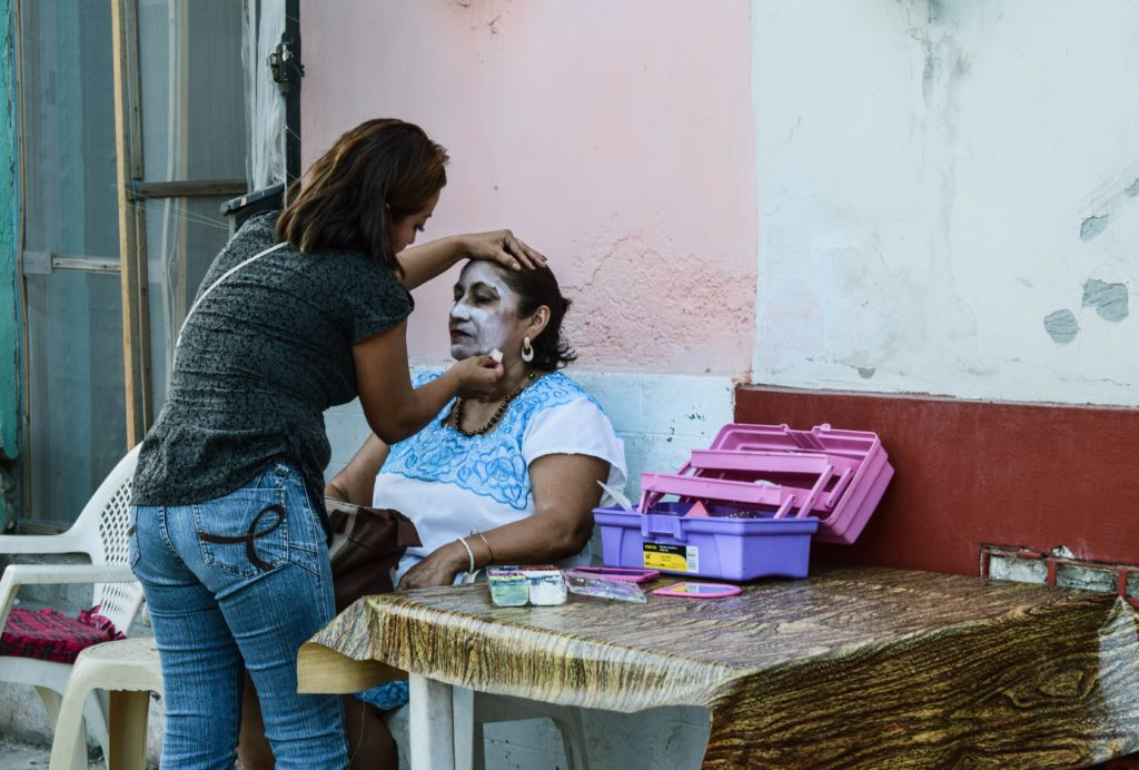 Putting on the Day of the Dead make up