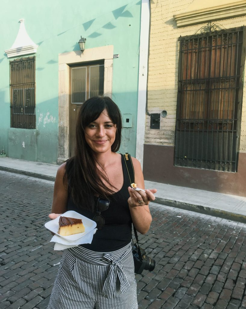 Eating Egg Cake at the Day of the Dead parade in Merida, Mexico
